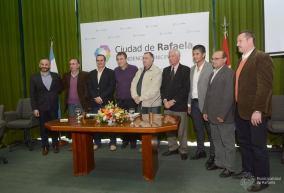 Firma de convenios de cooperación con las siete subsedes, 11 de junio de 2014.